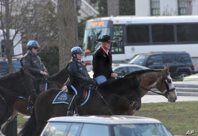 Interior Secretary Ryan Zinke arriving for his first day of work at the Interior Department in Washington, March 2, 2017, aboard 17-year-old Tonto.