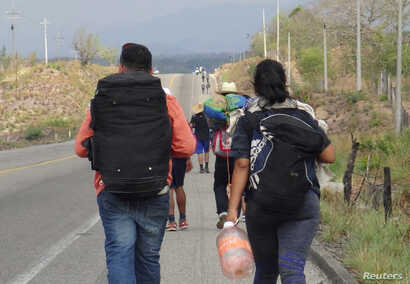 Central American migrants arrive at in Ixtepec, Oaxaca, Mexico, before continuing their journey to the United States, March 30, 2018.