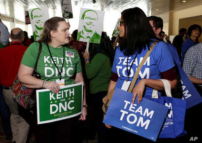 Supporters of Rep. Keith Ellison of Minnesota and former Secretary of Labor Tom Perez, candidates for Democratic National Committee chairman, speak to each other during a Democratic National Committee forum in Baltimore, Md., Feb. 11, 2017.