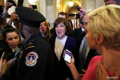 U.S. Sen. Susan Collins, R-Maine, leaves the Senate floor surrounded by Capitol police and reporters after the Senate voted to confirm the U.S. Supreme Court nomination of Judge Brett Kavanaugh at the U.S. Capitol in Washington, Oct. 6, 2018.