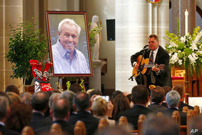 Country artist Vince Gill performs during a memorial service for golfer Arnold Palmer in the Basilica at St. Vincent's College in Latrobe, Pennsylvania, Oct. 4, 2016.