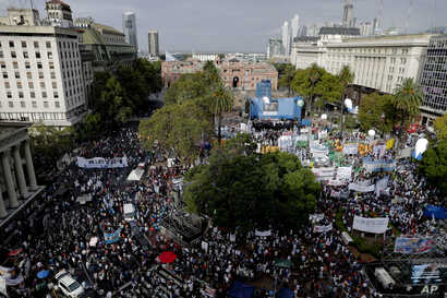 Protesters gather at Plaza de Mayo during a demonstration in Buenos Aires, Argentina, March 30, 2017.