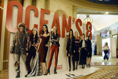 """An oversized movie advertisement for the upcoming film """"Ocean's 8,"""" featuring an all-female starring cast, is pictured on day one of CinemaCon 2018, the official convention of the National Association of Theatre Owners, at Caesars Palace in Las Vegas..."""