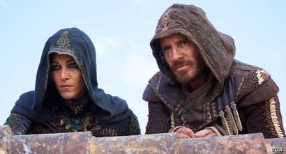 """Michael Fassbender and Marion Cotillard in a scene from """"Assassin's Creed"""" (Photo courtesy 20th Century Fox)"""