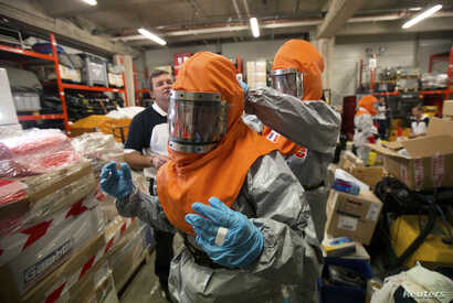 Volunteers who will be sent to Africa in the forthcoming days are taught how to work with patients infected with the Ebola virus during a training session at AP-HP hospital Henri Mondor in Creteil, a suburb of Paris October 22, 2014. At least 4,877 p...