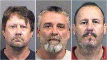 These Oct. 14, 2016 booking photos provided by the Sedgwick County Sheriff's Office in Wichita, Kansas, show, from left, Patrick Stein, Gavin Wright and Curtis Allen. They are members of a militia group and charged with plotting to bomb an apartment