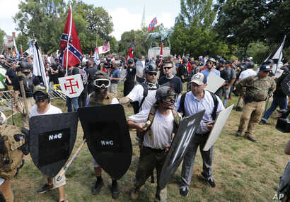 """Alt-right"" demonstrators clash with counter-demonstrators at the entrance to Lee Park in Charlottesville, Va., Aug. 12, 2017."