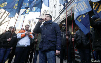 Activists hold a rally to demand a corruption investigation involving officials of Ukraine's defense procurement sector, near the Prosecutor General's Office in Kyiv, Ukraine, Feb. 27, 2019.