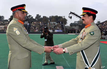 FILE - In this photo released by Inter Services Public Relations, the public relations arm of Pakistan's army, Pakistan's outgoing Army Chief Gen. Raheel Sharif, right, hands over a ceremonial baton to his successor Gen. Qamar Javed Bajwa during the ...