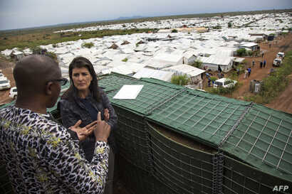 US Ambassador to the UN, Nikki Haley talks with a UN official during her visit at the UN Protection of Civilians (PoC) site in Juba, South Sudan, October 25, 2017.