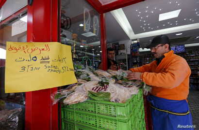 """An Arabic sign reads """"3 Syrian style bread 5 lira"""" is seen at a market in Istanbul, Turkey, February 17, 2016."""