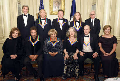 Teresa Heinz Kerry, front row, from left, Kennedy Center Honorees Al Pacino, Mavis Staples, Martha Argerich, James Taylor, and Kennedy Center President Deborah Rutter; rear row, from left, Secretary of State John Kerry, Kennedy Center Honorees Joe Wa...
