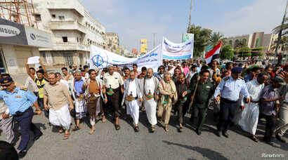 FILE - Pro-Houthi protesters demonstrate to demand the opening of humanitarian corridors in Hodeida, Yemen, Dec. 31, 2018.