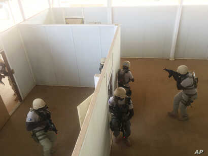 In this photo taken April 13, 2018. Nigerien police who are part of the U.S. Special Program for Embassy Augmentation and Response, known as SPEAR take part in the annual U.S.-led Flintlock exercise in Niamey, Niger.