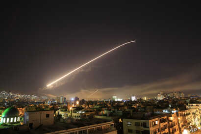 Missile fire lights up the Damascus sky, April 14, 2018.