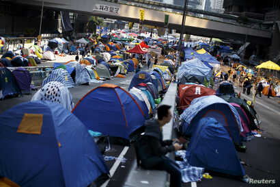 Protesters and tents occupy the main road to the financial Central district in Hong Kong, Dec. 9, 2014.