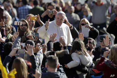 Pope Francis arrives for his weekly general audience in St.Peter's Square, at the Vatican, Wednesday, March 1, 2017.