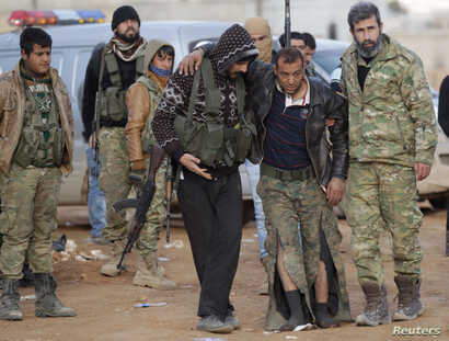 FILE - Free Syrian Army fighters help a fellow fighter, who was injured during fighting near Qabasin town, northern Syria, Jan. 12, 2017.