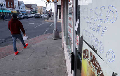 A sign alerts customers a bakery is closed for the day as part of an immigration protest, Feb. 16, 2017, in Perth Amboy, New Jersey.