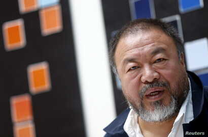 Chinese artist Ai Weiwei speaks to the media during a news conference ahead of an exhibition 'Chinese Whispers' at the Center Paul Klee in Bern, Switzerland on April 27, 2016.