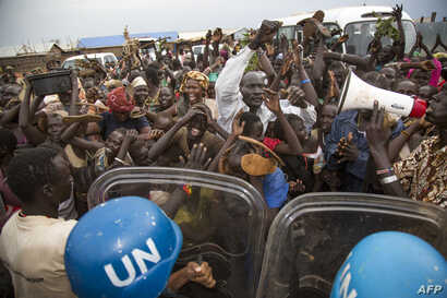 Internally Displaced People (IDP) demonstrate during the visit of the US Ambassador to the UN, at the UN Protections of Civilians (PoC) in Juba on October 25, 2017.
