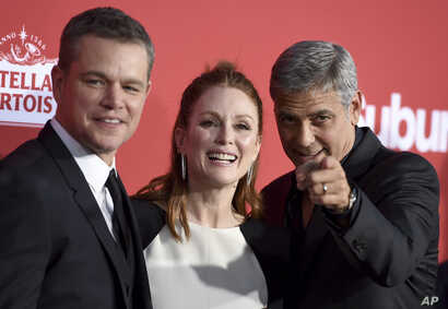 """FILE - From left, Matt Damon, Julianne Moore and George Clooney arrive at the Los Angeles premiere of """"Suburbicon"""" in Los Angeles, Oct. 22, 2017."""