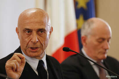 Italian Interior Minister Marco Minniti (L) and chief of police Franco Gabrielli attend a news conference in Rome, Italy, to announce that the suspect in the Berlin truck attack was killed in a shoot-out in a suburb of the northern Italian city of Mi...