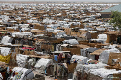 FILE - Huts and sheds are seen at the Gamboru/Ngala internally displaced persons (IDPs) camp in Borno, Nigeria