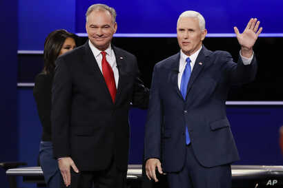FILE -- Republican vice-presidential nominee Gov. Mike Pence and Democratic vice-presidential nominee Sen. Tim Kaine, left, met at Longwood University in Farmville, Virginia, for their debate October 4, 2016.