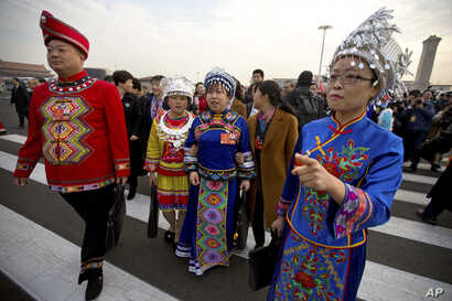 Delegates in ethnic minority dress arrive for the opening session of China's National People's Congress (NPC) at the Great Hall of the People in Beijing, March 5, 2018.
