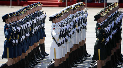 Chinese female military personnel march during a parade commemorating the 70th anniversary of Japan's surrender during World War II held in front of Tiananmen Gate, in Beijing, Thursday, Sept. 3, 2015.