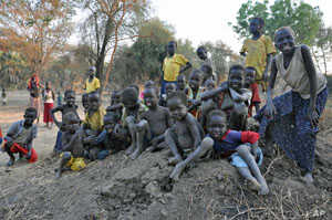 Kids play in the dirt at Doro refugee camp in South Sudan, December 2011.