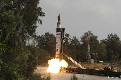 A surface-to-surface Agni V missile is launched from the Wheeler Island off the eastern Indian state of Odisha April 19, 2012