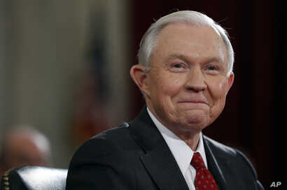 Attorney General-designate, Senator Jeff Sessions of Alabama, smile as he testifies on Capitol Hill in Washington, Jan. 10, 2017. He was confirmed by the Senate, Feb. 8, 2017.