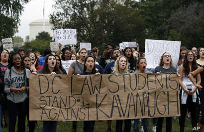 Activists demonstrate on the lawn of the East Front of the U.S. Capitol to protest the confirmation vote of Supreme Court nominee Brett Kavanaugh on Capitol Hill, Oct. 6, 2018, in Washington.