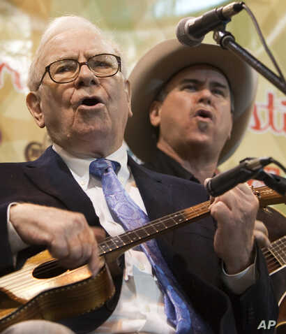 FILE - Berkshire Hathaway Chairman and CEO Warren Buffett plays the ukulele and sings with the Quebe Sisters Band prior to participating in an annual shareholders meeting in Omaha, Neb., May 1, 2010.