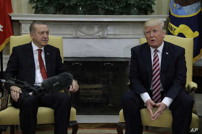 President Donald Trump meets with Turkish President Recep Tayyip Erdogan in the Oval Office of the White House in Washington, May 16, 2017.