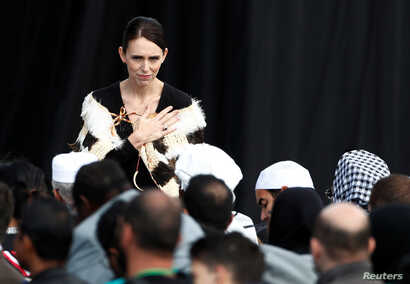 New Zealand's Prime Minister Jacinda Arden gestures to relatives of victims of the mosque attacks during the national remembrance service, at Hagley Park in Christchurch, New Zealand, March 29, 2019.