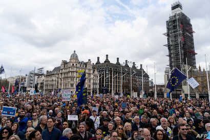 Crowds gather after the march to listen to speakers at a rally organized by the pro-European People's Vote campaign for a second EU referendum in Parliament Square, central London, March 23, 2019.