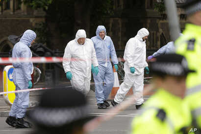 Forensic police investigate an area in the London Bridge area of London, June 5, 2017.