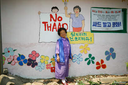 Do Geum-ryeon poses for photographs during an anti-THAAD protest, in Seongju, South Korea, June 14, 2017.