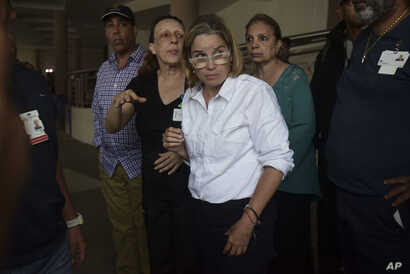 FILE - Mayor Carmen Yulin Cruz arrives at San Francisco hospital in Rio Piedras area of San Juan, Puerto Rico, Sept. 30, 2017.