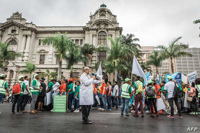 Scientist Professor Salim Abdool Karim, a South African epidemiologist and infectious diseases specialist, and one of the conveners of the march leads people during the 'March for Science' in Durban on April 14, 2018.