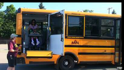 A Metropolitan Transportation Network bus picks up students for summer school in Minnesota, Aug. 8, 2017.