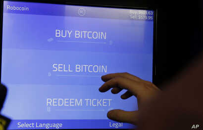 Christopher David uses a Robocoin kiosk to sell bitcoins outside of the 500 Startups' Bitcoinferance in Mountain View, Calif., March 20, 2014.