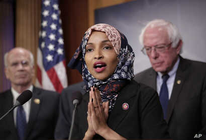 FILE - Representative Ilhan Omar, Democrat-Minnesota, center, is seen with fellow lawmakers during a news conference on Capitol Hill in Washington, Jan. 10, 2019.