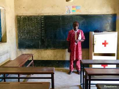 Adoumkidjim Naiban, the founder of CESER Center, stands in the classroom of the school he founded and built - the country's only school for mentally handicapped children. N'Djamena, Chad, Sept. 23, 2017.