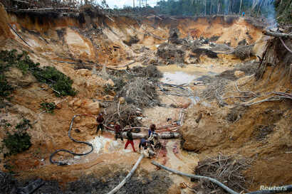 FILE PHOTO: An illegal mine is seen in the southern Venezuela state of Bolivar near the border with Brazil Nov. 17, 2012.