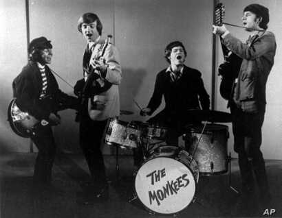 FILE - This 1966 photo shows The Monkees. Shown from left, are, Davy Jones, Peter Tork, Micky Dolenz and Mike Nesmith.