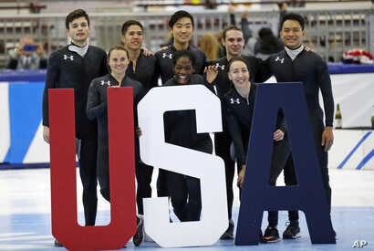 Nominees to the Olympic team, including Maame Biney (front row center), pose for a photo after the U.S.Olympic short track speedskating trials trials, Dec. 17, 2017, in Kearns, Utah.